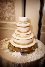 White Wedding Cake With Painted Gold Stripes