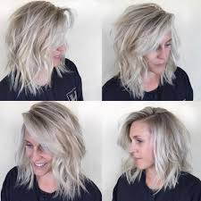 lob hairstyles with bangs women s undone textured lob with long side swept bangs and pale