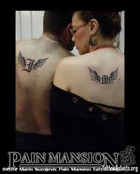 couple wings and initials tattoo pain mansion osijek tattoo