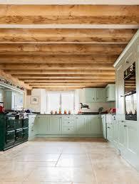 mint green kitchen with british racing green aga farmhouse