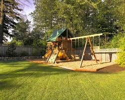 exterior good brown wooden slider and swing in brown wooden play