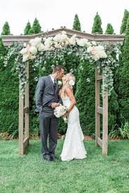 wedding arch leaves asheville wedding ceremony arch wooden arbor white hydrangeas