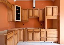 burnt orange kitchen white cabinets granite countertop burnt