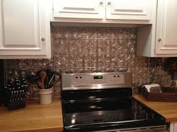 kitchen with metal backsplash smooth white countertop caramel