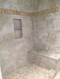 fantastic walk in shower with mosaic tile floor shower niche to
