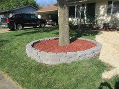 jumbo cobblestone border around tree installed by done right