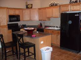 white or brown kitchen cabinets needs help but light oak cabinets with terra cotta colored floor