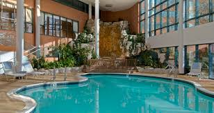 Home Plans With A Courtyard And Swimming Pool In The Center Hilton Long Island Huntington Ny Hotel Near Melville