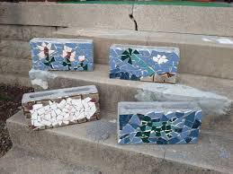 i made mosaic cinder block planters will be planting herbs in the
