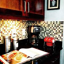mosaic glass backsplash kitchen mosaic glass backsplashes under wooden cabinets in the kitchen