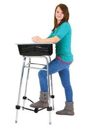 Picture Of Student Sitting At Desk This Really Works A Standing Desk With A Band To Kick Pump