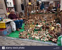 a stall selling carved wooden ornaments in whitby market place