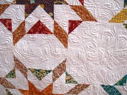 happy quilting free motion quilting echoed paisleys