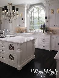 white kitchen cabinets black tile floor white cabinets black countertops marble