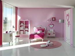 beautiful girls bedroom with pink round carpet and white color of
