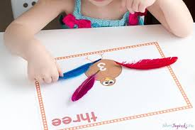how to make turkey feathers turkey counting mats with free printables