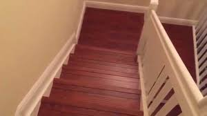 Install Laminate Flooring Over Concrete Installing Laminate Wood Flooring Staircase With White Riser Youtube