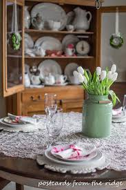 spring table and hutch tulips and pastels and lace oh my