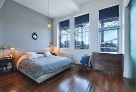 contemporary master bedroom with wall sconce by the corcoran