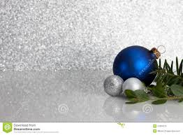 blue and silver christmas ornaments on glitter royalty free stock