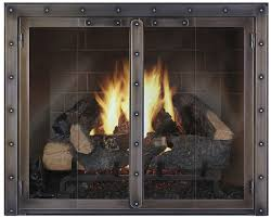 stainless steel double glass fireplace doors at brick wall design