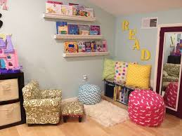delighful kids reading corner design with square pattern cushion