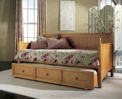 Pull Out Daybed Bedroom Wood Daybed With Pull Out Trundle Using Rounded Knobs In