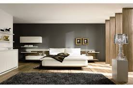 grey wall paint decorating with grey soft carpet also white grey wall paint decorating with grey soft carpet also white bedlinen and pillows also nightstand also shelving also wooden laminate flooring in modern