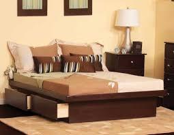 dark walnut king size platform bed without headboard next to white