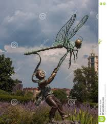 Dragonfly Garden The Boy And The Dragonfly Stock Photo Image 74791051