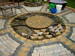 Paving Stone Designs For Patios by Wow Thats A Busy Garden Creating A Paver And Pebble Mosaic Patio