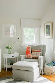 nursery glider in nursery transitional with white roman shades