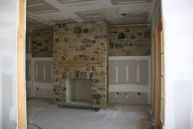 stone faced fireplace fabulous country style living room with