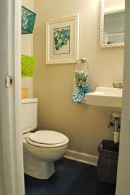 ideas for designing small bathroom two toned accents abstract painting the wall and colorful basket small towel add colour for