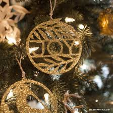 paper cut gold ornaments for your tree lia griffith
