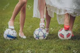 wedding shoes for grass wedding shoes and bridesmaids on a soccer stock