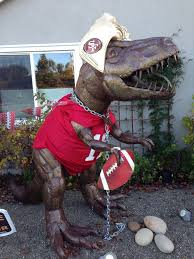 dressing up a dinosaur statue in costumes my disguises we