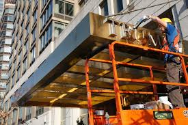 new york workers pry u0027trump plaza u0027 name off nyc apartment buildings
