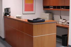 L Shaped Reception Desks Small L Shaped Reception Desk With Wall Mounted Wood Cabinet Nytexas