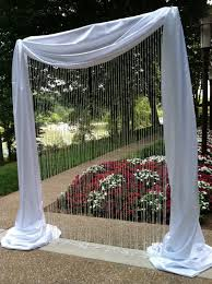 wedding backdrop ideas with columns something like this minus pink crap at top for