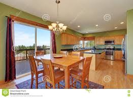 Kitchen Green Kitchen Colors Stock Dining Room And Kitchen With Green Walls And Hardwood Floor Stock