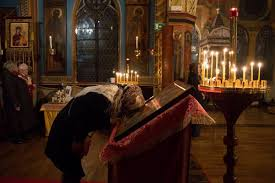 a woman prays during the vigil mass at the russian orthodox church