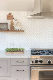 25 best herringbone backsplash ideas on pinterest small marble marble herringbone backsplash kitchen floating shelves nina jizhar design