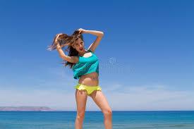 naughty preteens brunette teen in bikini and beachwear enjoys the stock photo image