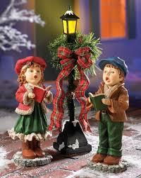 whimsical singing caroler lighted l post