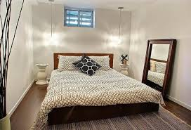 basement bedroom ideas small basement bedroom ideas neutral colors framed mirror bedside