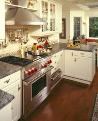 kitchen with red accents home design ideas