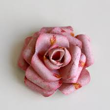 paper roses out three flowers using a 6 petal flower punch of course you can
