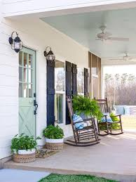 exterior curb appeal blue door black shutters iron planter