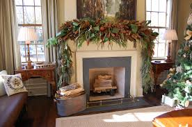 christmas mantel decorated with natural greenery in southern